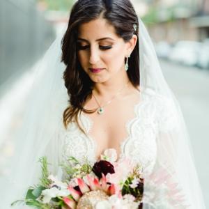 kim starr wise wedding florals in new orleans with blush, burgundy, ivory, plum, white, green bridal bouquet