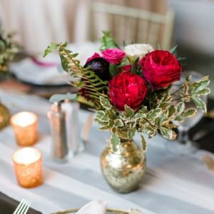 gold mercury bud vase hot pink red variegated sword fern pittosporum ranunculus lisianthus ivory wine centerpiece