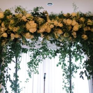 dark natural wood chuppah decor top cluster floral accent smilax vine ceremony marche jewish wedding tallit