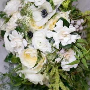 new orleans winter wedding floral arrangements kim starr wise latrobes bridal bouquet with gardenias, garden roses, ranunculus, anemones
