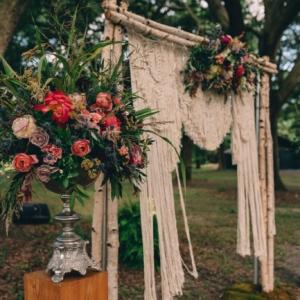 new orleans wedding floral arrangements kim starr wise macrame wedding altar backdrop boho style