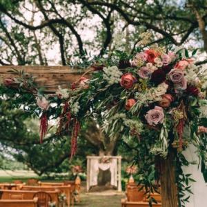 new orleans wedding floral arrangements kim starr wise 061017 ceremony entrance cascading asymmetric floral arrangement
