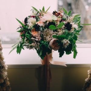 bridal bouquet for fall wedding in new orleans louisiana arrangement with dahlias, scabiosa, stock, ranunculus, blushing bride protea, astilbe, zinnias, foliage, herbs